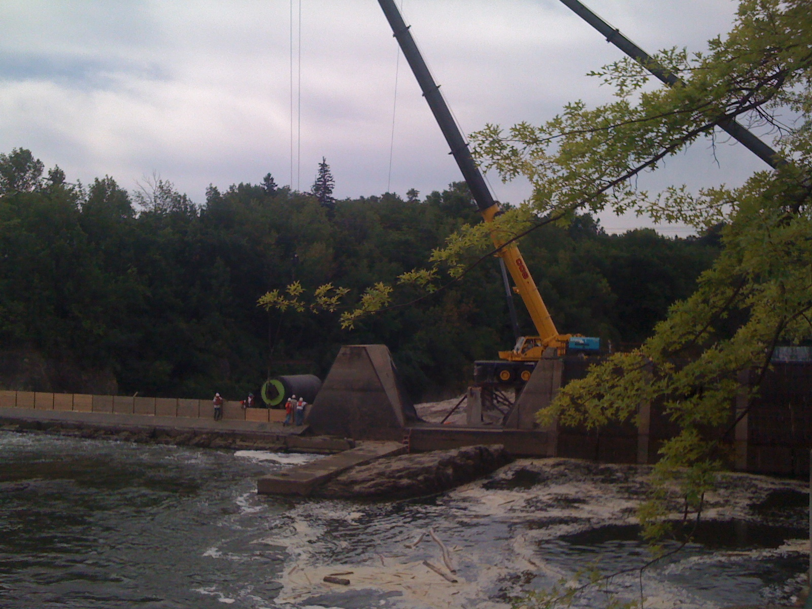 Rolling out a new membrane-Winooski Dam, VT